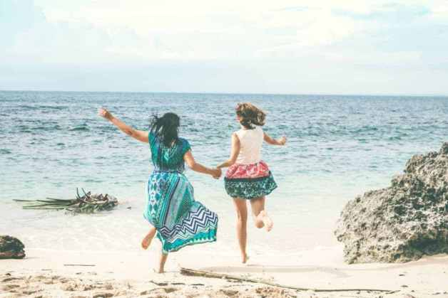 Canva-Two-Women-Running-At-The-Beach-scaled-e1582511609247
